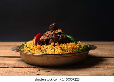 Traditional Ramadan Kurban food Pilaf in cast iron skillet. Copy space. Low key.