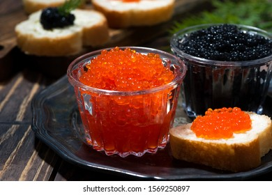 traditional red and black caviar and sandwiches on plate, closeup