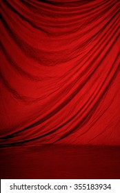 Traditional red canvas or muslin fabric cloth studio backdrop or background, suitable for use with portraits, products and concepts such as stage, theater or performance.