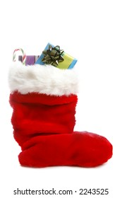 A traditional red Christmas stocking over white with gifts