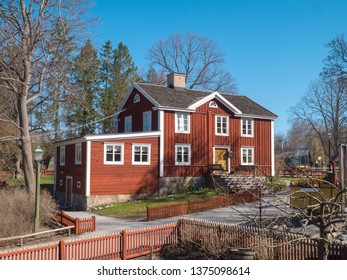 Traditional red colored Swedish house with white windows