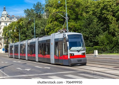 Traditional red electric tram in Vienna, Austria in a beautiful summer day