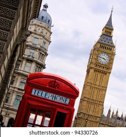 Traditional red English telephone box with the Tower of Big Ben