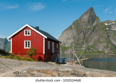 Traditional red house in typical landscape on Lofoten islands in northern Norway. Lofoten is a popular tourist destination.