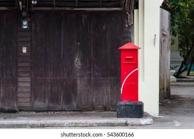 Traditional red post box in Thailand