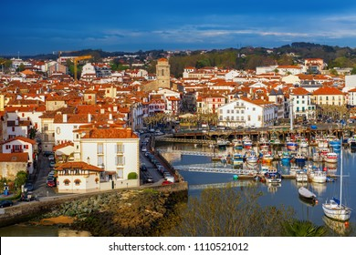 Traditional red and white basque houses in the Old Town of Saint Jean de Luz, Basque Country, France