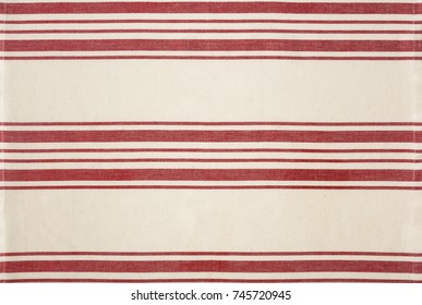 Traditional red and white striped cotton fabric kitchen bistro style tea towel tablecloth. Simple, classic, rustic country home cooking design element for banner, border or background. One of a set.