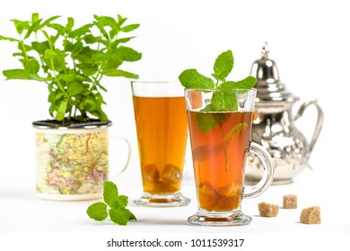 Traditional refreshing Arab mint tea. Isolated on the white background.