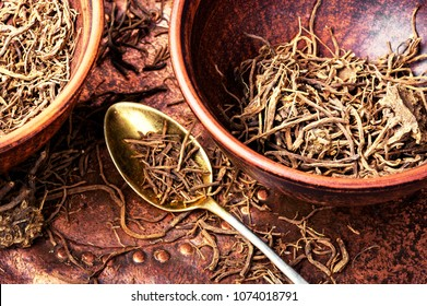 Traditional remedy from valerian roots in a mortar.Herbal medicine