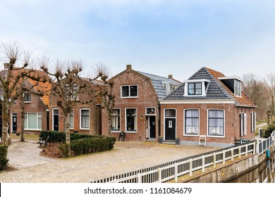 Traditional residential buildings and canal in Hindeloopen, Netherlands.