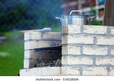 a Traditional rich bbq fireplace, made from brics, in garden