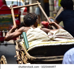 Traditional rickshaw pullers of Kolkata, India captured from the local streets.