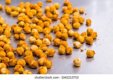 Traditional roasted chickpeas with spicy spices. Selective focus.