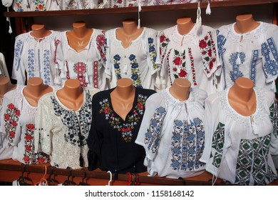 Traditional Romanian folk blouses exposed for sale at one traditional fair