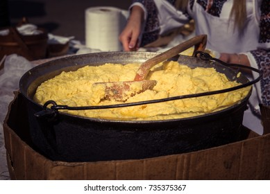 Traditional Romanian food, hominy (mamaliga) prepared in a caldron on fire