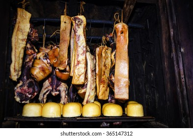 Traditional romanian smoke house full of pork and cheese