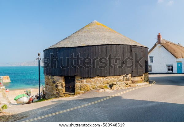Traditional Round House next to the harbour at Sennen Cove Cornwall England UK Europe
