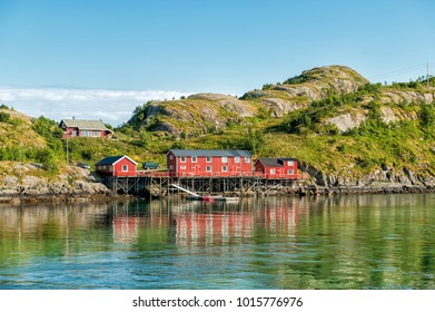 Traditional rural buildings in coast landscape on Lofoten islands in northern Norway. Lofoten is a popular tourist destination.