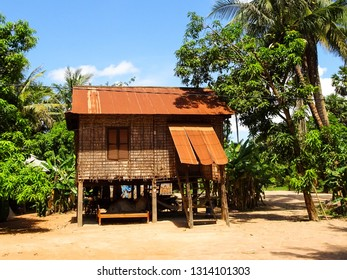 traditional rural khmer house in Cambodia (Southeast Asia), wooden house standing on stilts as a protection from annual floods, picture from floating village Kampong Phluk at shore of Tonle Sap lake
