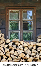 Traditional rural window with logs below.