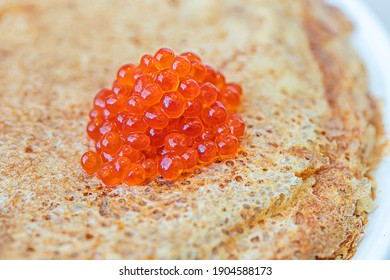 Traditional Russian appetizer of pancakes and red caviar, an expensive dish on Shrovetide, before lent.