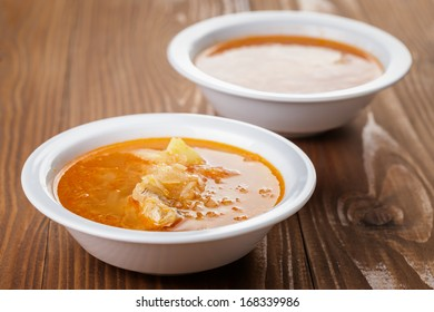 traditional russian cabbage soup shchi, on wooden table