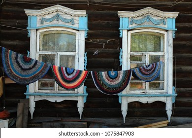 Traditional Russian carpets and windows of the wooden house. Tomsk. Siberia. Russia