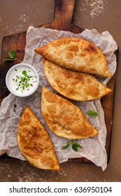 Traditional russian and caucasian pies - meat chebureks fried in oil.