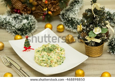 traditional russian christmas salad olivier sausage stock photo