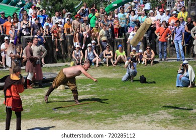 Traditional Russian daring. Russia, July 2013: Throwing a large log at the festival of medieval traditions. The village of Abalak. Tobolsky district. Siberia.