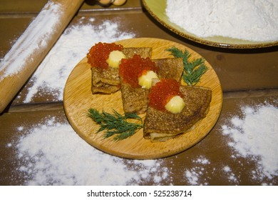 Traditional Russian dessert - fried pancakes. Favorite Russian food.