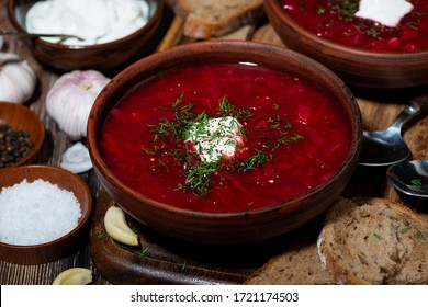 traditional russian dish borsch with sour cream, top view closeup