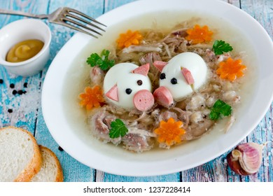 Traditional russian dish kholodets, jellied pork meat aspic decorated with boiled eggs, vegetables and herbs