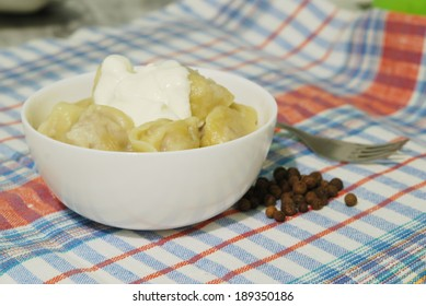 Traditional Russian dumplings with sour cream