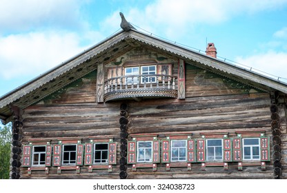 Traditional Russian house (tower-room) with carved platbands in museum of Russian wooden architecture -  Arkhangelsk, Russia