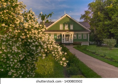 Traditional Russian manor of the late 18th century. Pushkin's family nest. House Museum. Lush blooming of snow-white jasmine in the foreground. Russia. Pskov. Pushkin mountains.