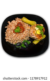 Traditional Russian meal - cooked buckwheat with a chicken steak isolated on white background