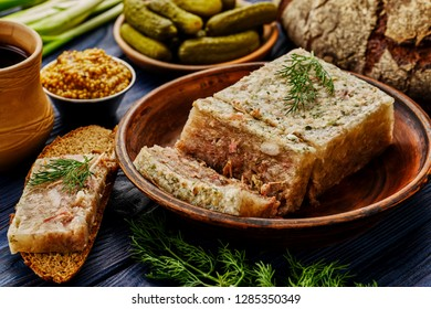 Traditional Russian meat aspic with mustard. Jellied meat.