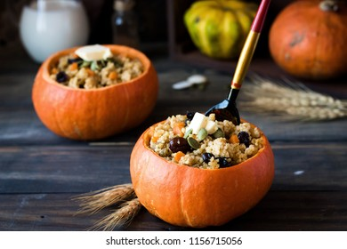 Traditional Russian millet porridge with raisins and pumpkin stewed in the oven. Pumpkin serving instead of plates