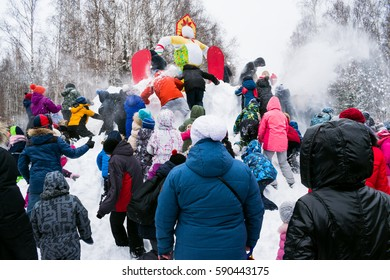 Traditional Russian national games at the Mardi Gras celebration taking the winter fortress with the effigy of winter