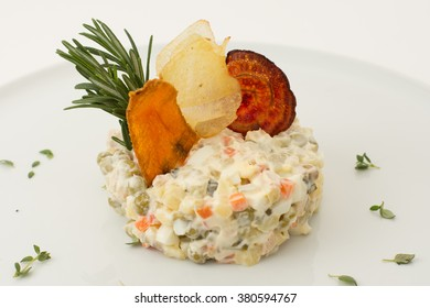 "Traditional Russian salad ""Olivier"" isolated on white"