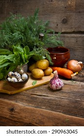 Traditional Russian shchi ingredients: onions, carrots, potatoes, sorrel, dill, garlic, broth and quail eggs