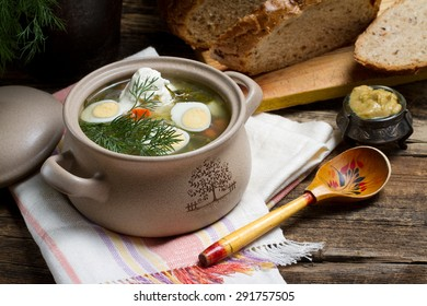 Traditional Russian shchi with onions, carrots, potatoes, sorrel, dill, garlic, sour cream and quail eggs