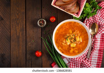 Traditional Russian soup with cabbage - sauerkraut soup - shchi. Flat lay. Top view