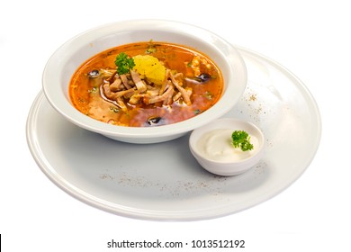 Traditional Russian soup Solyanka with meat cuts, smoked meats, lemon and olives