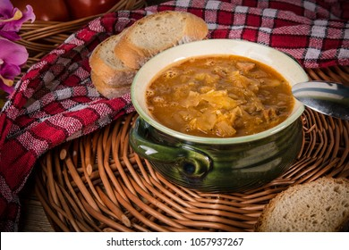 Traditional russian sour cabbage soup on wicker napkin.