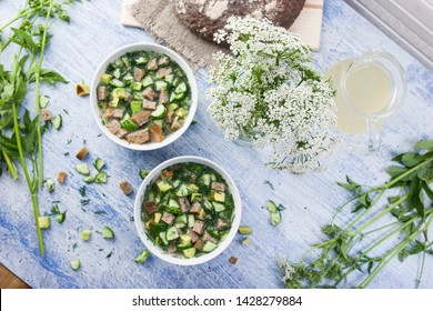 Traditional russian summer soup okroshka, vegan version with cucumber, dill, avocado bread and kvass