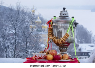 Traditional russian tea with samovar on the background of old Russian city as part of Goden Ring