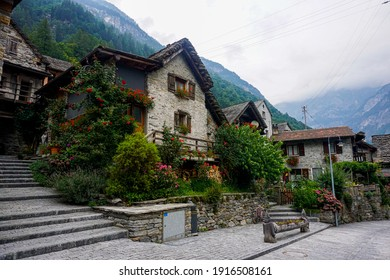 Traditional rustic stone house with lots of flowers spotted in the beautiful village Sonogno, Ticino, Switzerland
