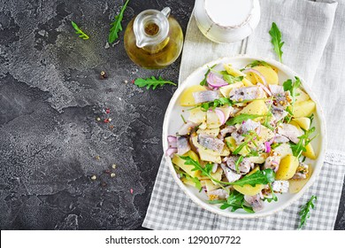 Traditional  salad of salted herring fillet, fresh apples,  red onion  and potatoes. Kosher food. Scandinavian cuisine. Top view. Flat lay